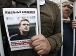 A man holds a portrait of opposition leader Alexey Navalny during a protest rally in Moscow
