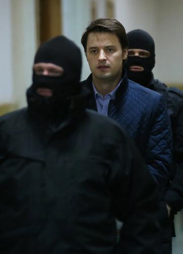 Борис Колесников под конвоем