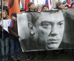 People hold banner of Kremlin critic Nemtsov during march to commemorate him in central Moscow