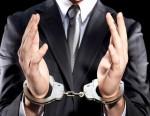 Businessman hand cuffed